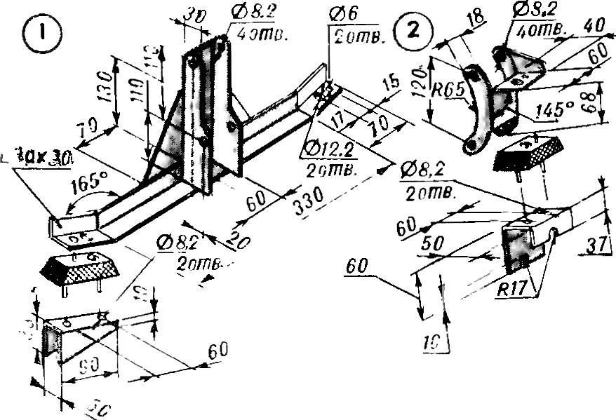 Передний (1) и задний (2) кронштейны крепления двигателя.