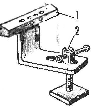 Fig. 6. The armrest of a simple machine: 1 — line. 2 — clamp.