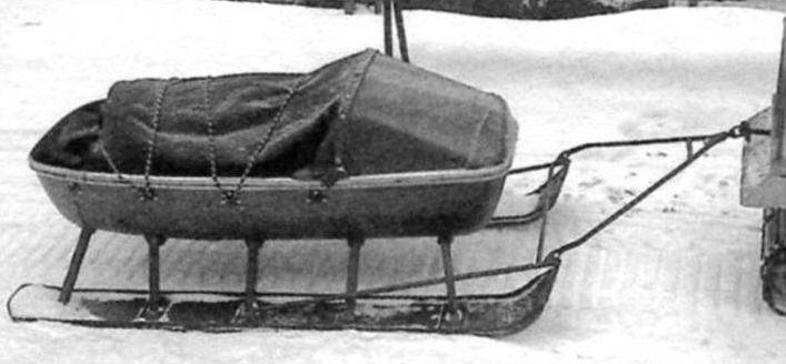 Sled trailer for a snowmobile