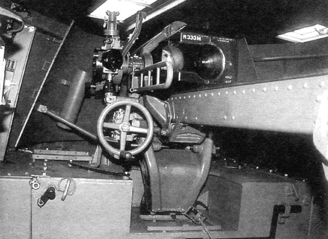 Fighting compartment installation. In the center-front of the optical sight, below the lifting mechanism of the howitzer, to the right - breech howitzers