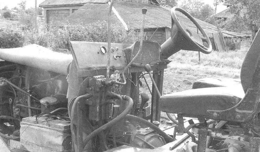 The controls of the tractor. Left-side view