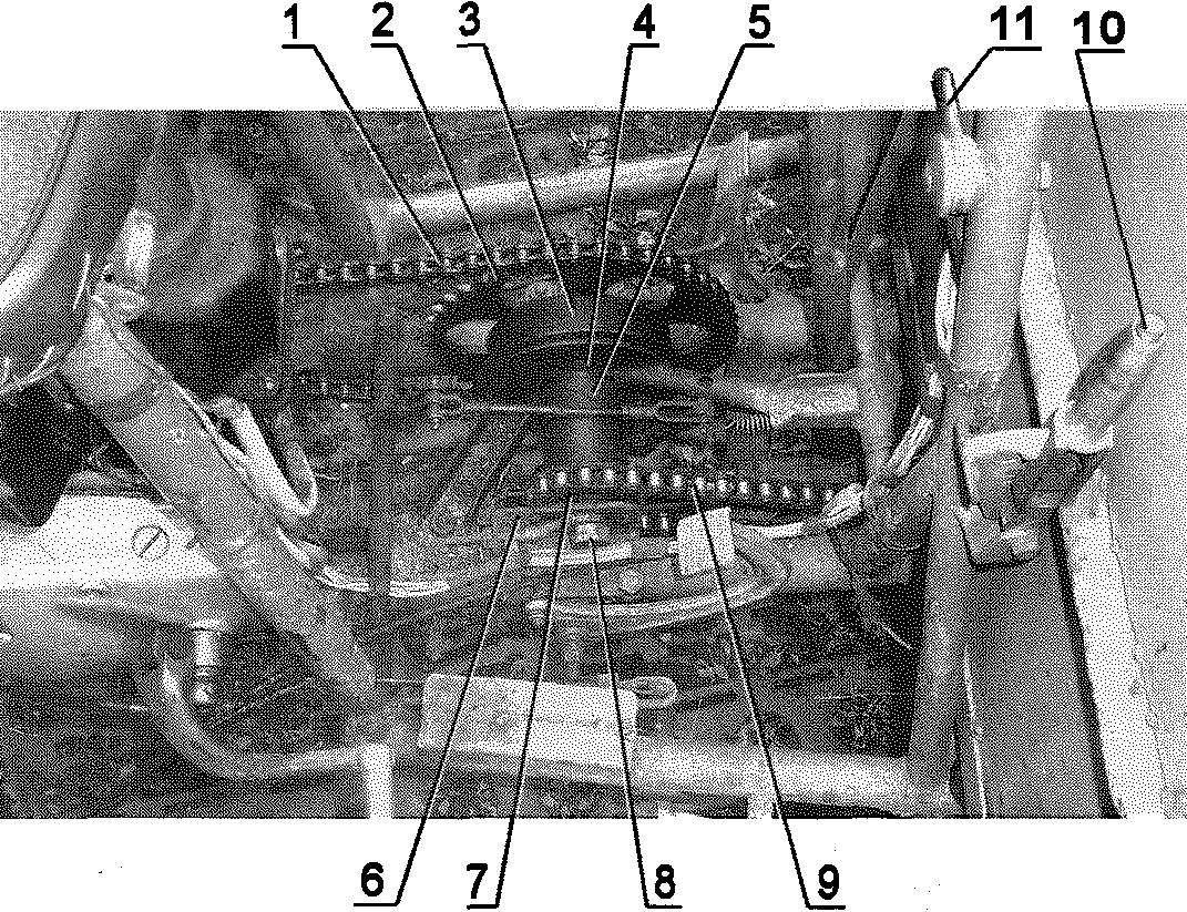 Промежуточный редуктор двухступенчатой цепной передачи