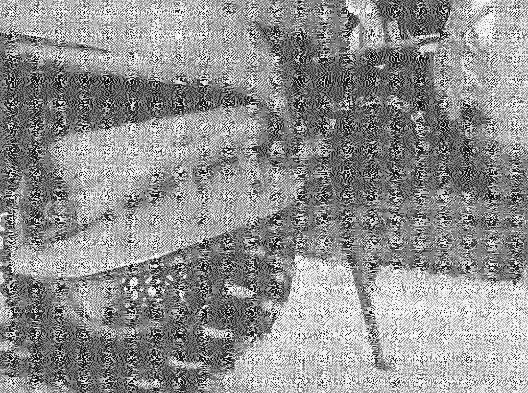 Цепная передача с промежуточным валом-редуктором: на переднем плане над ведомой звездочкой промежуточного вала видны звездочка выходного вала двигателя и цепь ПР-12,7 первой ступени.
