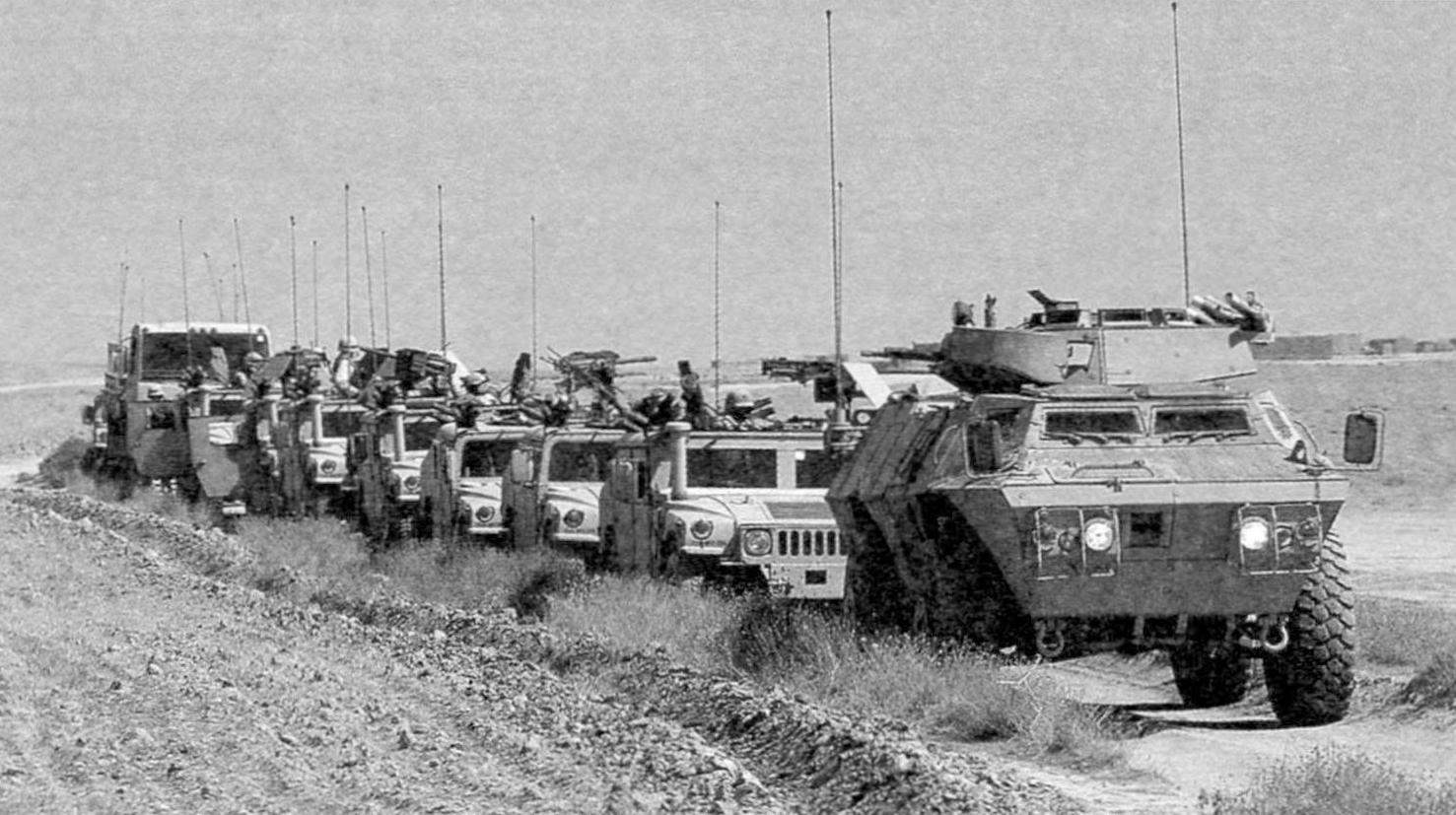 M 1117 accompanied by a convoy of armored cars