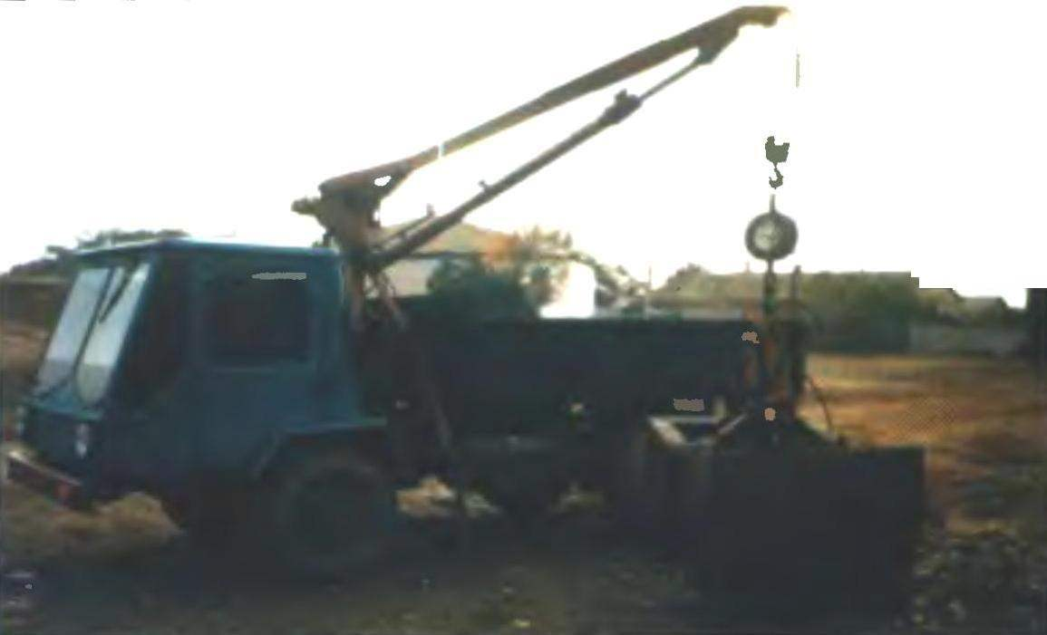 THE TRUCK WITH MANIPULATOR
