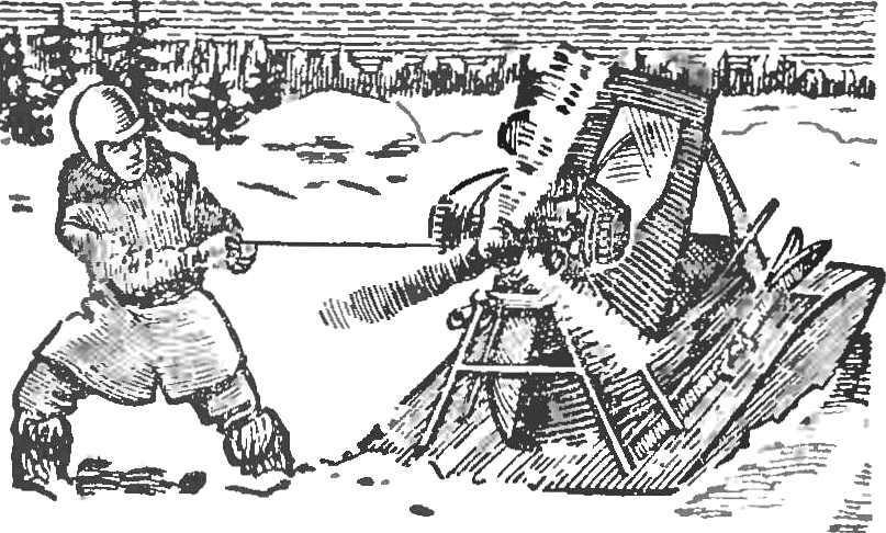 Рис. 8. Аэросани-лыжи П. Н. и Н. П. Петровых. Момент запуска двигателя.