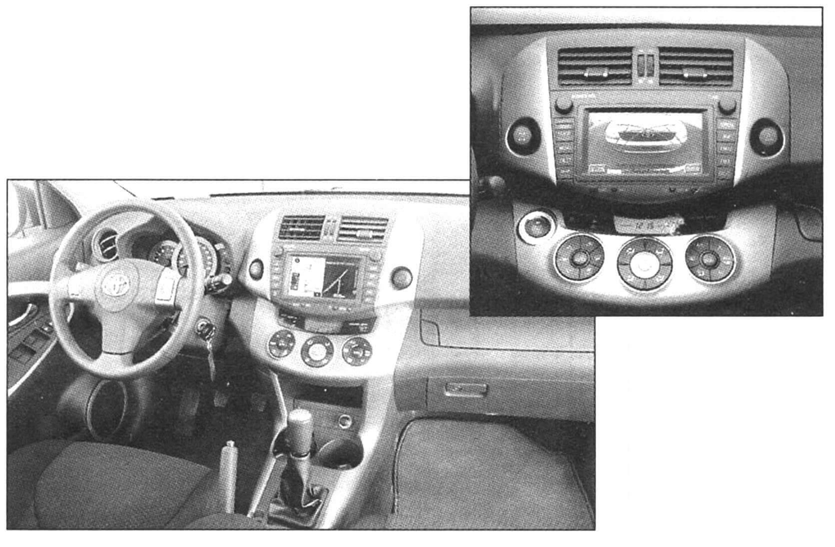 Интерьер рабочею места водителя. Справа - дисплей навигационной системы и видеокамеры заднего обзора